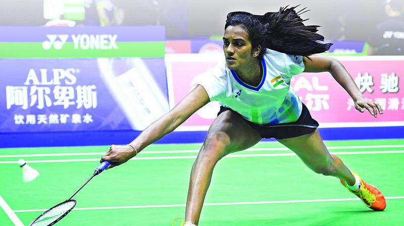 P. V. Sindhu returns to Malaysia's Goh Jin Wei during their women's singles match of the Sudirman Cup badminton championships in Nanning, China, on Tuesday. Sindhu won 21-12, 21-8. (Photo: AFP)