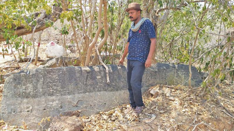 Archeological researcher A. Manikandan at the site near Pudukkottai. (Photo: DC)
