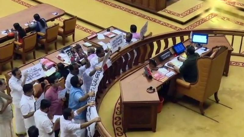 The Kerala Assembly Speaker rejected sanction for the notice of adjournment motion and also took strong objection to holding placards by the Opposition so as to hinder the view of the Chair. (Photo: ANI | Twitter)