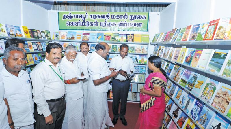 R.Duraikannu, state Agriculture minister and R. Vaithilingam MP browsing books at the book fair after inauguration at Thanjavur on Saturday. (Photo: DC)