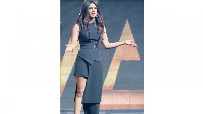 Priyanka Chopra sports an asymmetrical dress during the promotions of Baywatch