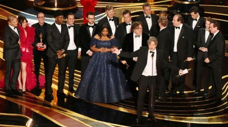 Producers accept the best picture Oscar for 'Green Book,' which has taken more than USD 140 million in box offices worldwide but sparked controversy. (Photo: AFP)