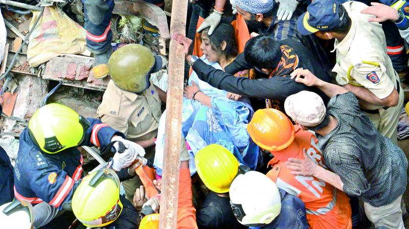 NDRF personnel carry out rescue operation at the collapse site of the four-storey Kesarbai building at Dongri in Mumbai, on Tuesday, which killed 11 people besides trapping 40 others. (Photo: DC)