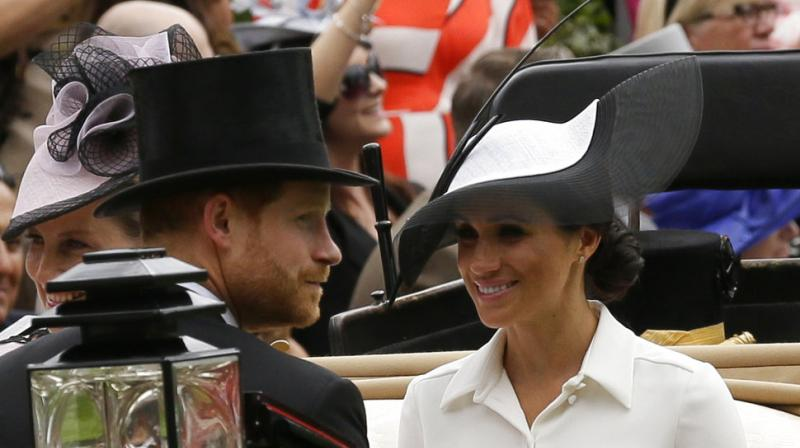 Britain's Prince Harry and Meghan Duchess of Sussex arrives at the parade ring with Prince Edward Earl of Wessex and Sophie Countess of Wessex in a horse drawn carriage on the first day of the Royal Ascot horse race meeting in Ascot