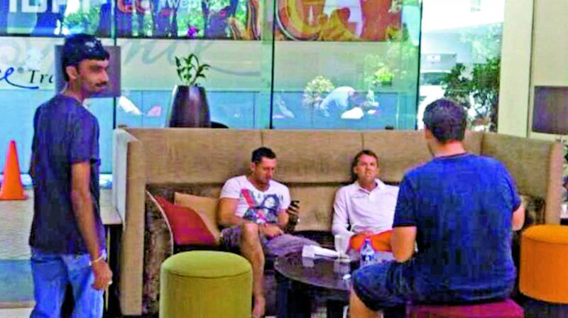 A screengrab from Al-Jazeera's sting operation shows alleged fixer Aneel Munawar (left) in a hotel lobby in Sri Lanka. Former England players Graeme Swann and Tim Bresnan are also seen.