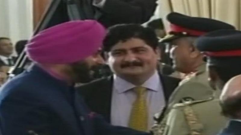 Navjot Singh Sidhu met Pakistan Army Chief General Qamar Javed Bajwa with a hug at the Imran Khan's oath-taking ceremony in Islamabad. (Photo: Twitter / ANI)
