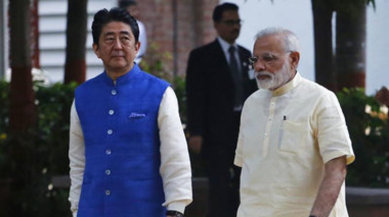 Shinzo Abe, Narendra Modi  Japanese Prime Minister Shinzo Abe, left, and Indian Prime Minister Narendra Modi walk inside Sabarmati Ashram, or Gandhi Ashram, in Ahmadabad, India.