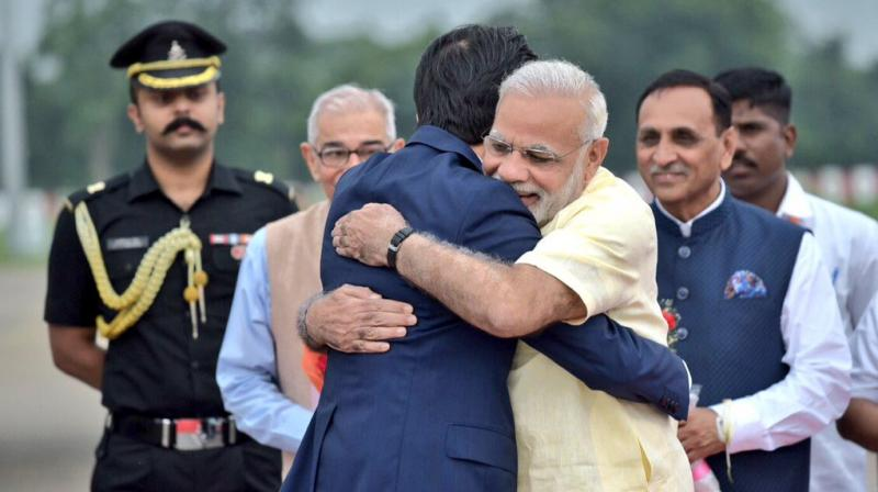 Japanese Prime Minister Shinzo Abe arrived in Ahmedabad on Wednesday evening and was treated to a warm hug from Prime Minister Narendra Modi.