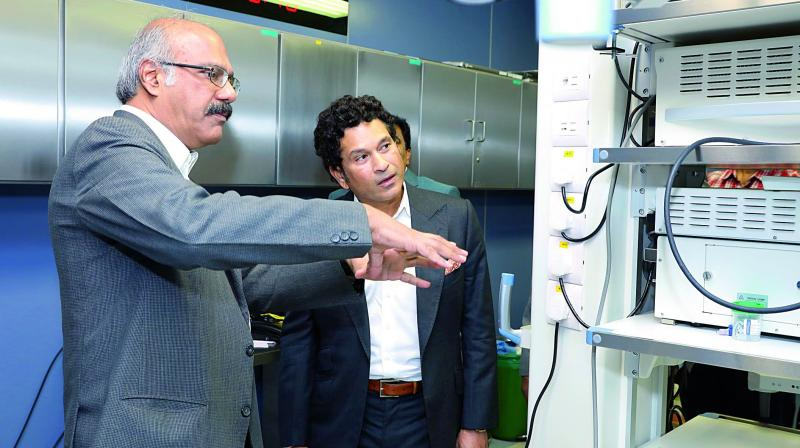 Asian Institute of Gastroenterology chairman Dr Nageshwar Reddy gives a personal tour to Sachin Tendulkar of the hospital campus.