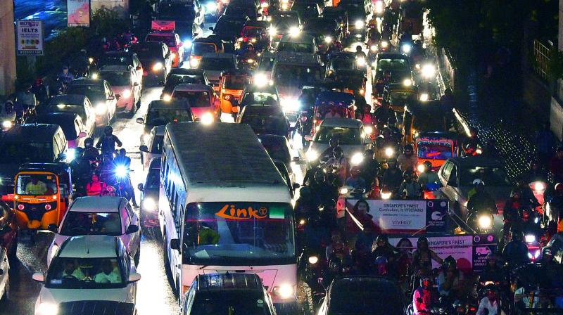 Commuters had a harrowing time as traffic came to a standstill following heavy rain at Hitec City on Tuesday night. Traffic also went haywire in the city. (R. Pavan)