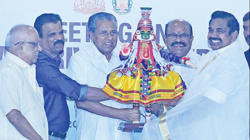 Chief Minister Pinarayi Vijayan presents a replica of kathakali dancer to his Tamil Nadu counter part Edappadi K. Palaniswami on the sidelines of the inter state river water sharing talks held in Thiruvnanthapuram on Wednesday.  	 (AV MUZAFAR)