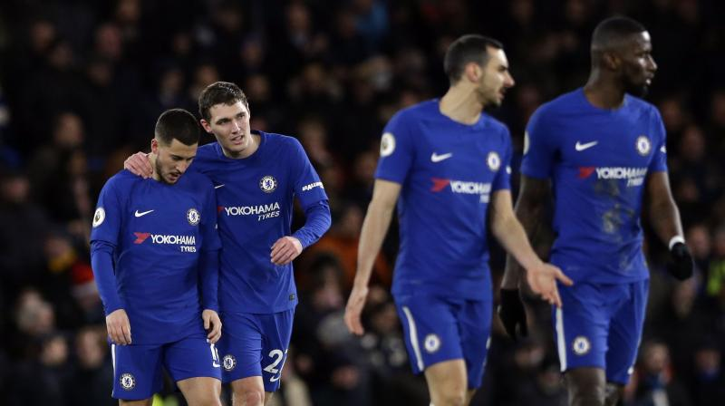 Eden Hazard's (extreme left) two goals helped Chelsea climb into fourth with the gap between Manchester United in second and fifth-placed Tottenham Hotspur now just four points. (Photo: AP)