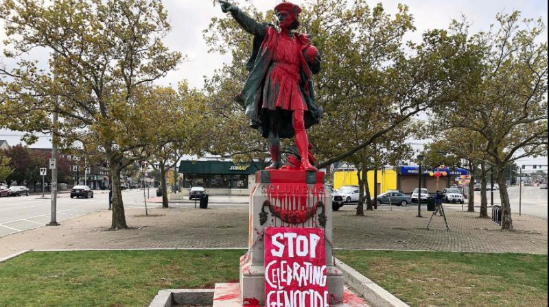 A statue in Providence, Rhode Island, was splashed from head to toe Monday with red paint, and a sign reading