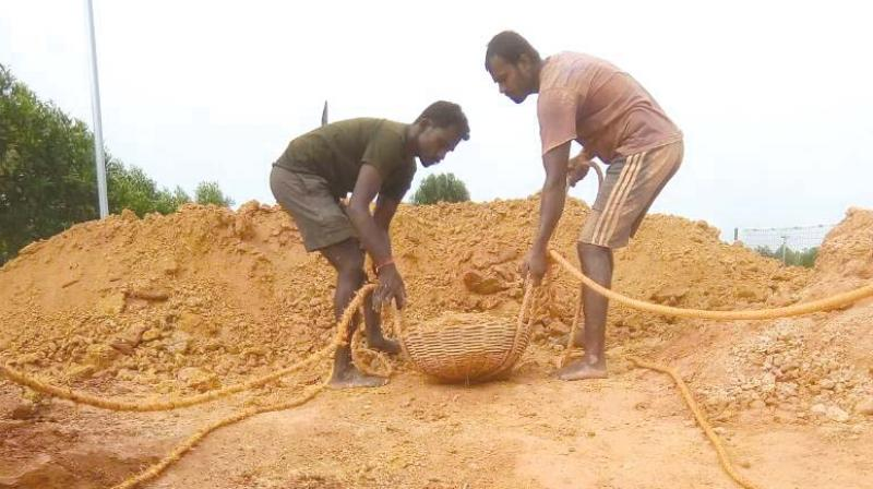 The 'Manuvaddars' have given up their traditional job of well digging and are helping households install rain water harvesting systems (Photo: DC)