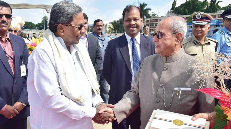 Chief Minister Siddaramaiah seeing off President Pranab Mukherjee at HAL Airport in Bengaluru on Sunday (Photo: KPN)