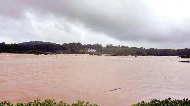 Tunga river overflows at Theerthahalli near Shivamogga on Thursday 	(Photo:  KPN)