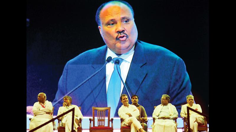 Martin Luther King III seen addressing on a giant screen as Nobel laureate Kailash Satyarthi, Congress V-P Rahul Gandhi & CM Siddaramaiah listen, in Bengaluru on Friday (Photo:  Shashidhar B.)