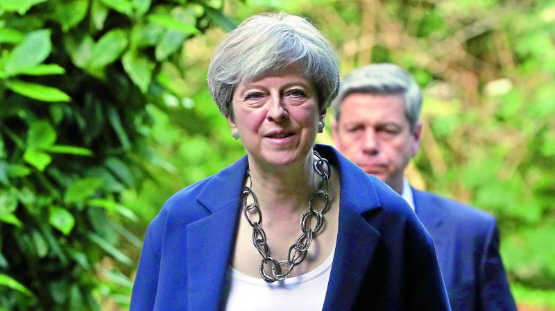 British Prime Minister Theresa May's spokesman said Britain had thwarted nine plots in the past 12 months. (File photo)