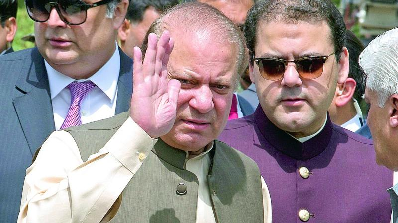 Pakistan's former PM Nawaz Sharif with his son Hassan Sharif (FIle Photo)