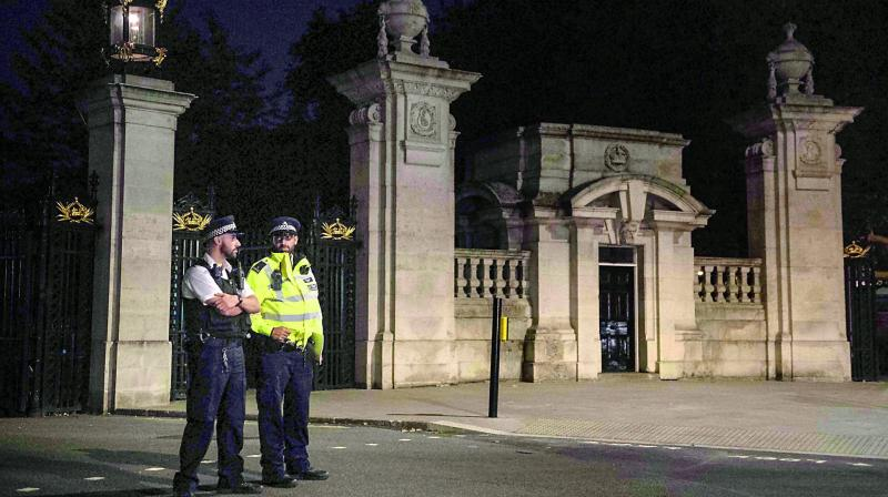 Police stand guard outside the palace on Saturday (Photo: AFP)