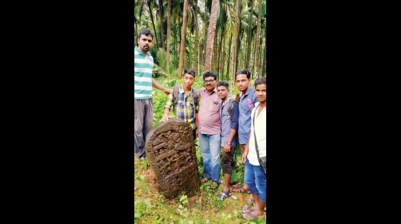 Students of MSRS College, Shirva with a  sculpture of the Tulu holy spirit Siri (Photo: DC)