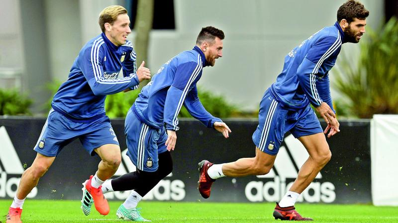 7332d284928 Argentina s Lionel Messi (centre) at a training session in Buenos Aires