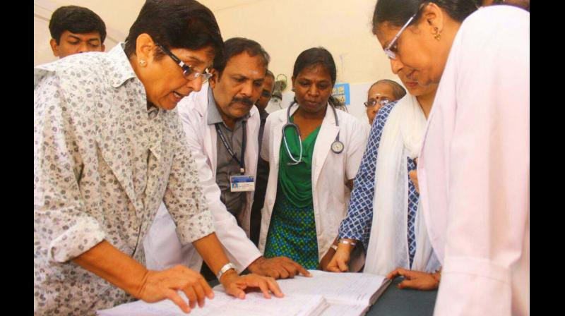 Bedi checks hospital records during her visit to the government hospital in Karaikal on Wednesday. (Photo: DC)