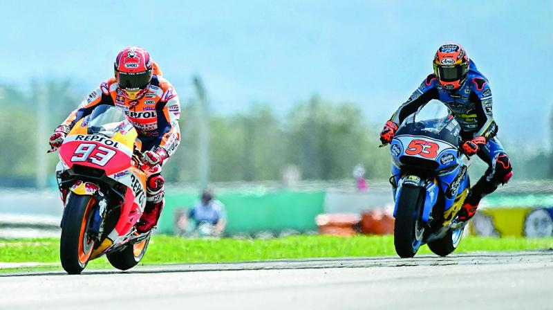Repsol Honda's rider Marc Marquez rides during the third practice session of the Malaysia MotoGP at the Sepang International circuit in Sepang, Malaysia on Saturday. (Photo: AFP)