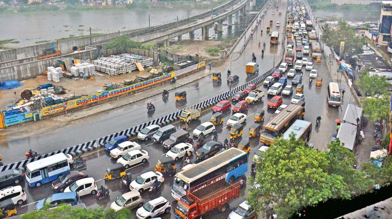 Aerial view of traffic on Saidapet flyover due to waterlogging on Anna Salai.(Photos by N. Sampath and E.K. Sanjay)