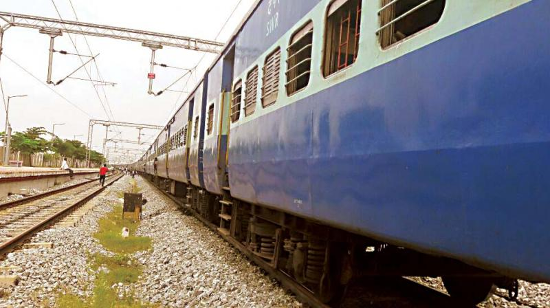 Tipu Super Fast Express train was held at Byadrahalli near Mandya owing to track repairs on Thursday. (Photo: DC)