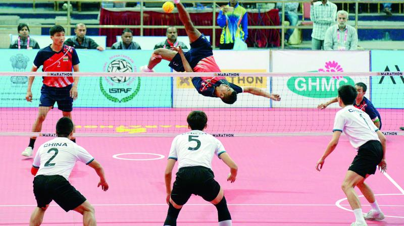 A player from the Indian team smashes during the Sepak Takraw World Cup match against China at the Gachibowli Stadium in Hyderabad on Friday.
