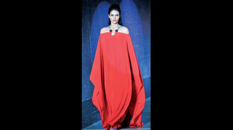 This flowy red tunic is classy yet understated
