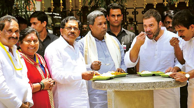 Chief Minister Siddaramaiah, Bengaluru Development Minister K.J. George and Congress vice-president Rahul Gandhi at the launch of Indira Canteen in this file photo