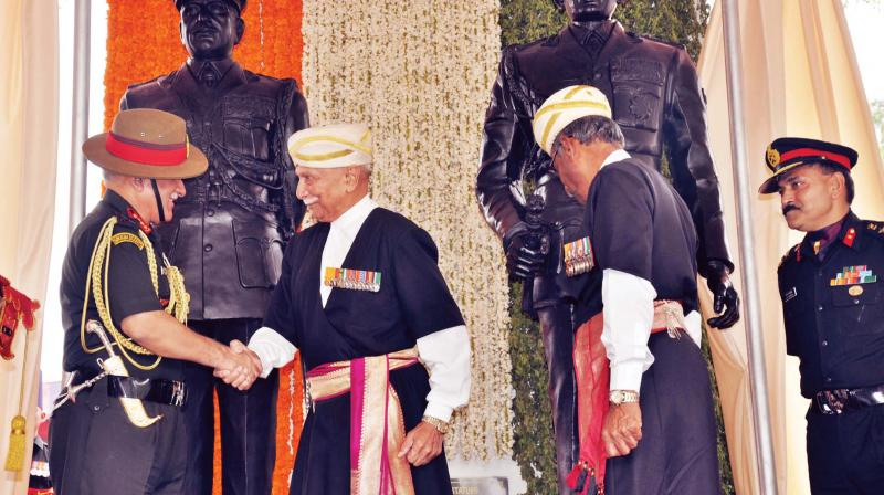 Kodava ex-servicemen greet Army chief Gen Bipin Rawat who unveiled the statues of  Field Marshal K.M. Cariappa and General K.S. Thimayya at Cauvery College at Gonikoppa in South Kodagu on Saturday (Photo: KPN)