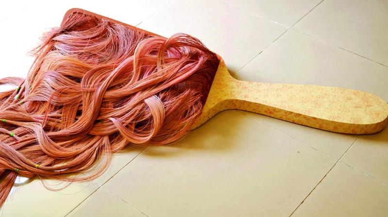The gigantic hair brush holding thick, pinkish strands of hair symbolises every woman's nightmare of the lock of hair caught in the brush
