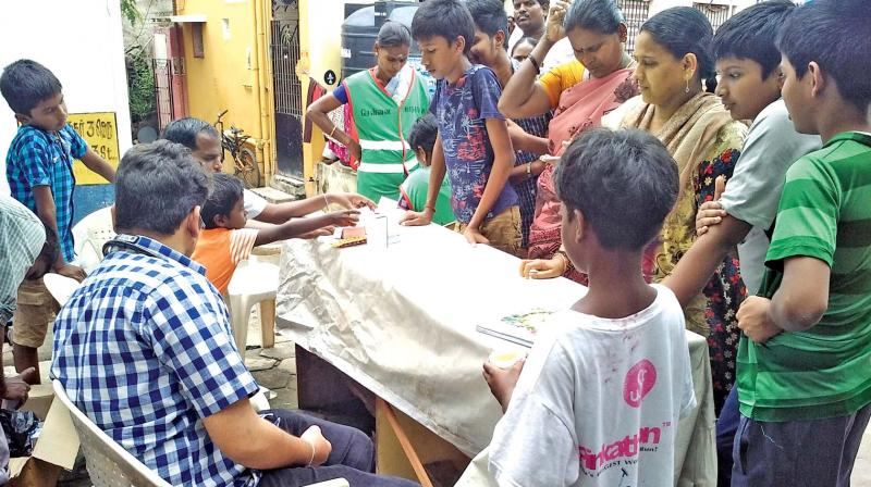 Residents flock to a medical camp in Ramapuram on Sunday. (Photo: DC)