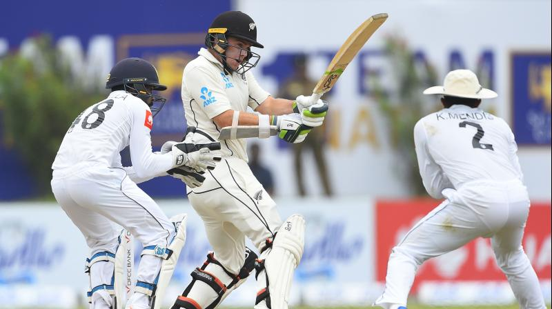 Tom Latham tries to play a shot during the third day of the opening Test cricket match between Sri Lanka and New Zealand. (Photo:AFP)