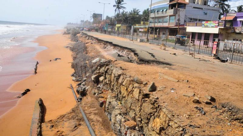 The walkway, seats and infrastructure at the Shangumugham beach damaged by high waves.