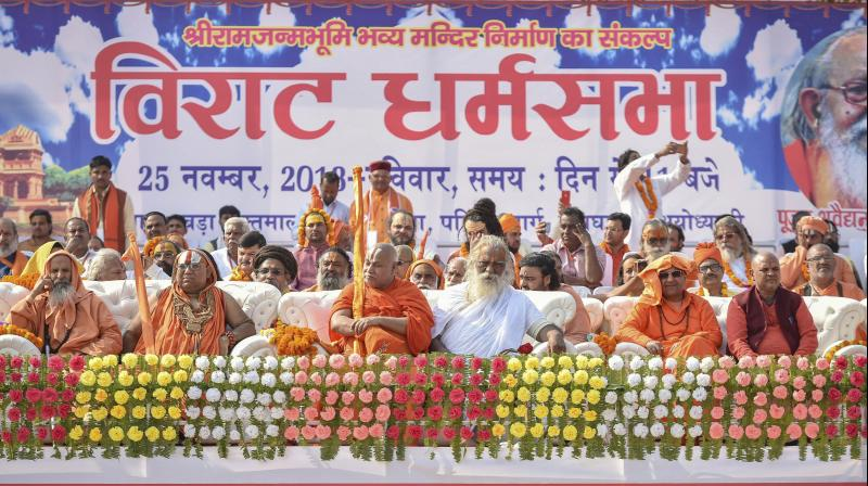 Seers from different ashrams gather at the programme venue as they participate in Dharam Sabha, organised by the VHP. (Photo: PTI)