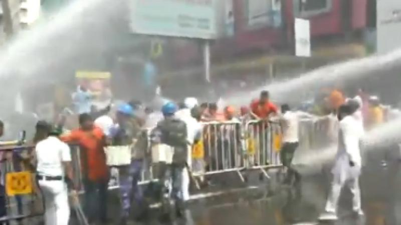 The police used water cannons, tear gas and barricades to stop the protesters when they turned violent. (Photo: Twitter | ANI)