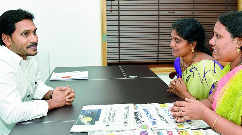 Chief Minister Y.S. Jagan Mohan Reddy listens to members of Kalyana Mitra at Tadepalli camp office on Friday. (Photo: DC)