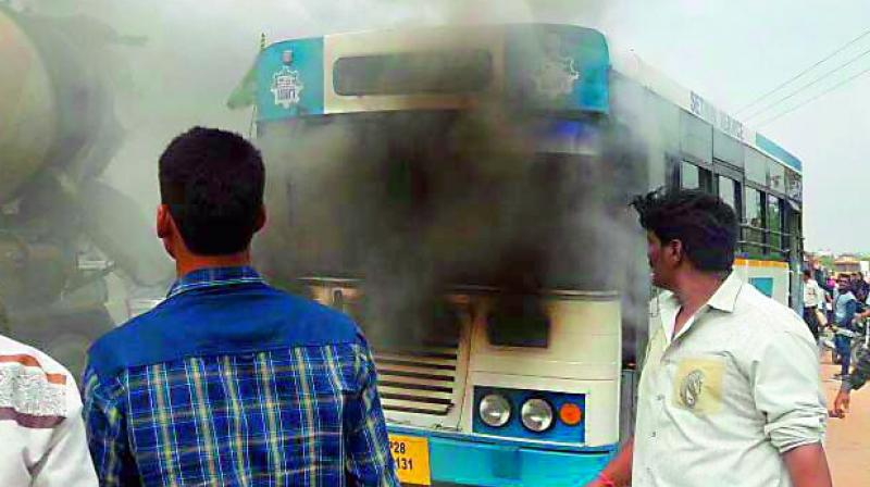 Smoke comes out of a Setwin bus at Shamshabad on Sunday