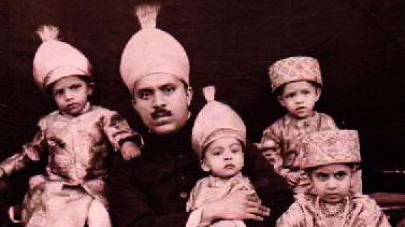 Prince Hasham Jah Bahadur along with his children.