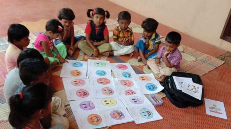 Prapti Foundation  volunteers teaching students at an Anganwadi centre in Bengaluru