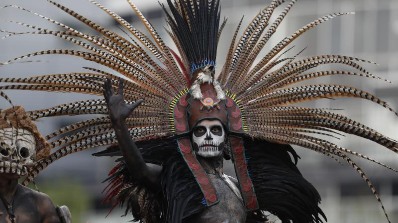 More than 700 performers prepared for months for the colorful afternoon procession along more than 4 miles (7 km) of the expansive Paseo de la Reforma. (All photos: AP)