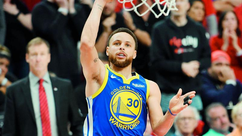 Stephen Curry of the Golden State Warriors shoots against the Portland Trail Blazers in Game Four of the NBA Western Conference Finals at Moda Center in Portland, Oregon on Tuesday. (Photo: AFP)