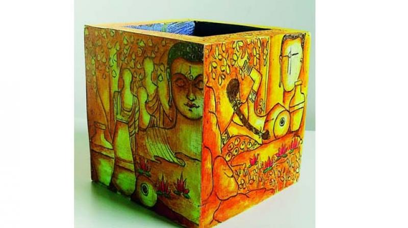 One of the pen stand created by Kishan showcasing Lord Buddha's philosophy.