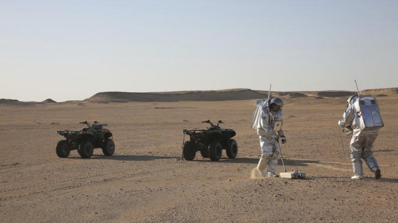 This photo shows two scientists test space suits and a geo-radar for use in a future Mars mission in the Dhofar desert of southern Oman. The desolate desert in southern Oman resembles Mars so much that more than 200 scientists from 25 nations organized by the Austrian Space Forum are using it for the next four weeks to field-test technology for a manned mission to Mars. (Photo: AP)