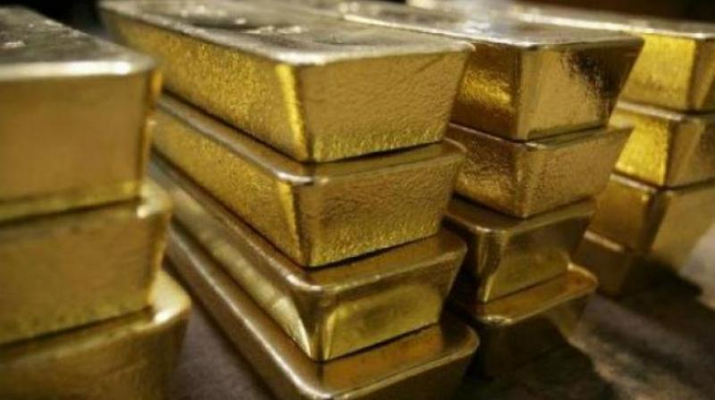 Spot gold was trading lower at USD 1,287.10 an ounce, while silver was down at USD 15.01 an ounce in New York.  (Representational Image)