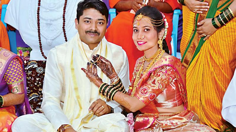A bride ties mangalsutra to the groom at Nalathwad village of Muddebihal taluk in Vijayapura district.